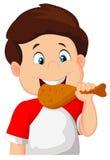 Menino dos desenhos animados que come o frango frito Fotografia de Stock Royalty Free