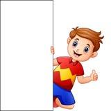 Menino dos desenhos animados que dá os polegares acima com guardar o sinal vazio Fotografia de Stock