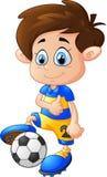 Menino dos desenhos animados que joga o futebol Foto de Stock Royalty Free