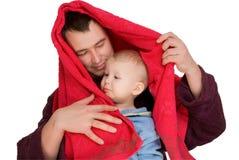 Menino e bathrobe vestido homem fotografia de stock royalty free