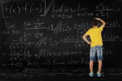Menino e matemáticas imagens de stock royalty free
