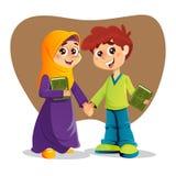 Menino e menina com o livro santamente do Corão Imagem de Stock Royalty Free