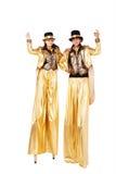 Menino e menina em pernas de pau Imagem de Stock Royalty Free