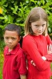 Menino e menina infelizes foto de stock royalty free