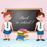 Menino e menina na farda da escola. Fotos de Stock Royalty Free