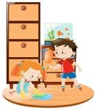 Menino e menina que fazem trabalhos domésticos junto Imagem de Stock Royalty Free