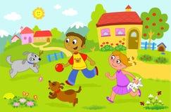 Menino e menina que jogam com cães Fotos de Stock Royalty Free