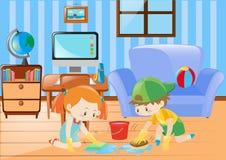 Menino e menina que limpam o assoalho Fotografia de Stock Royalty Free