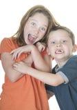 Menino e menina que olham amedrontados imagem de stock royalty free