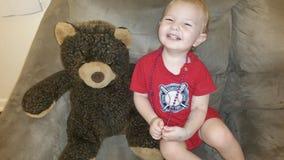Menino e o seu urso Foto de Stock Royalty Free