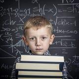 Menino e quadro-negro de escola Foto de Stock Royalty Free