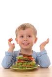 Menino e sanduíche grande Imagem de Stock Royalty Free