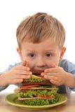 Menino e sanduíche grande Foto de Stock Royalty Free
