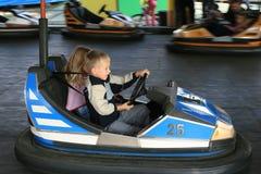 Menino e uma menina na feira de divertimento Foto de Stock Royalty Free