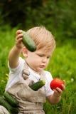 Menino e vegetais Imagem de Stock Royalty Free