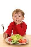 Menino e vegetais Imagens de Stock Royalty Free