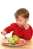 Menino e vegetais Foto de Stock Royalty Free