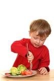 Menino e vegetais Fotos de Stock