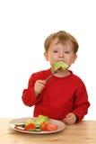 Menino e vegetais Fotos de Stock Royalty Free