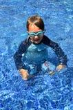Menino em óculos de proteção vestindo de uma associação Fotografia de Stock Royalty Free