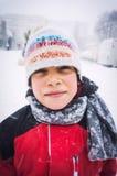 Menino em congelar o tempo frio Foto de Stock Royalty Free