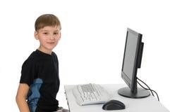 Menino em seu computador Imagens de Stock