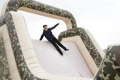 Menino em um brinquedo inflável imagens de stock royalty free