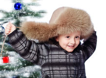 Menino em um chapéu morno Fotos de Stock