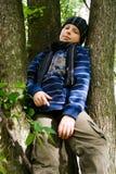 Menino em uma árvore Fotografia de Stock