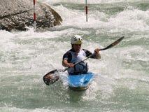 Menino em uma canoa Foto de Stock Royalty Free