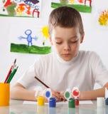 Menino em uma classe de desenho Fotografia de Stock