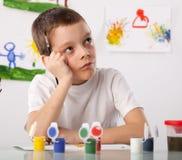 Menino em uma classe de desenho Foto de Stock