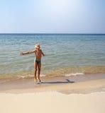 Menino em uma praia Imagem de Stock Royalty Free