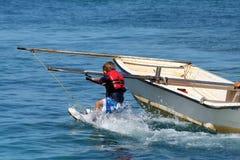 Menino em waterskis Fotos de Stock Royalty Free