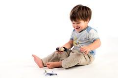Menino feliz com brinquedos Imagens de Stock Royalty Free
