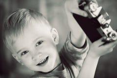 Menino feliz com a câmera retro nas mãos Imagens de Stock Royalty Free