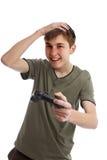 Menino feliz com controlador do jogo imagem de stock royalty free