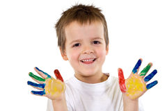 Menino feliz com mãos pintadas Imagem de Stock Royalty Free