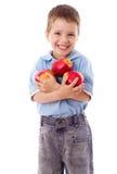 Menino feliz com maçãs vermelhas Foto de Stock