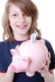 Menino feliz com piggybank Fotografia de Stock Royalty Free