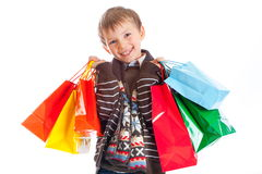 Menino feliz com sacos de compra foto de stock royalty free
