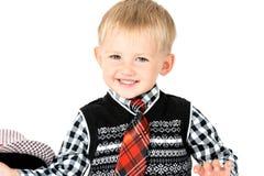 Menino feliz de sorriso com o tiro do estúdio do laço isolado em um backg branco Imagem de Stock