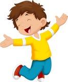 Menino feliz e salto Imagem de Stock