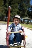 Menino feliz no campo de jogos Imagem de Stock