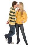 Menino feliz que beija uma menina agradável Imagem de Stock Royalty Free