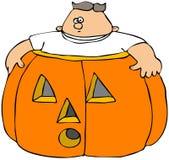Menino gordo em uma abóbora Imagens de Stock Royalty Free