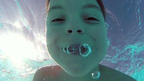 Boy in pool Stock Footage