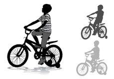 Menino na bicicleta Imagens de Stock Royalty Free