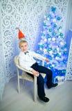 Menino na cadeira imagem de stock royalty free