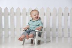 Menino na cadeira com cerca Fotografia de Stock